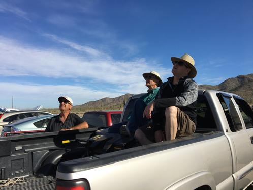 Visitors From Palm Creek Watch The Flying From Their Truck
